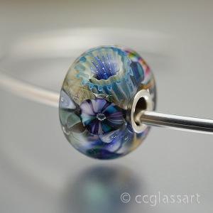 ocean blue encased murrini bead