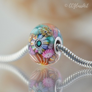 Encased murrini big hole bead with sterling silver core