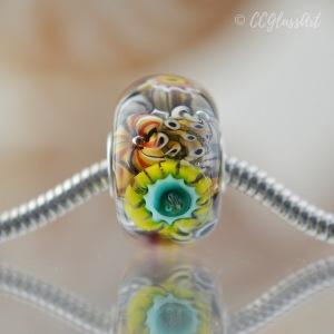 Handmade lampwork encased murrini bead