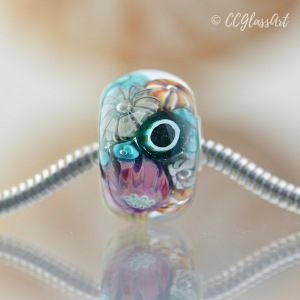 Handmade lampwork encased murrini bead