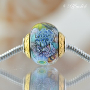 Encased murrini big hole bead with brass bead caps