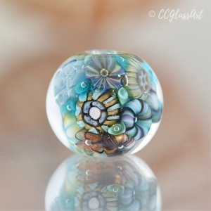Handmade Lampwork glass art bead with encased murrini