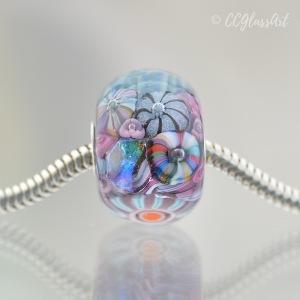 Handmade Lampwork glass art bead with encased murrini